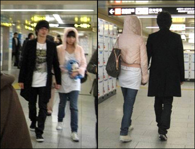 Son Ho Young and Kim Ji Woo holding hands in Japan