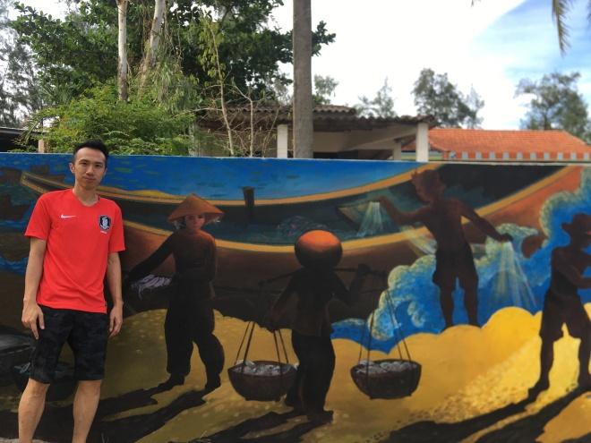 Posing against a wall mural